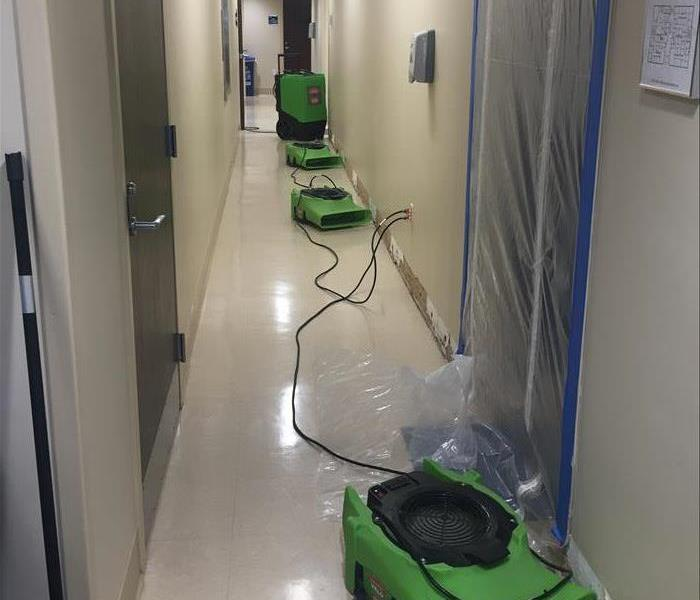 Air movers in university hallway.